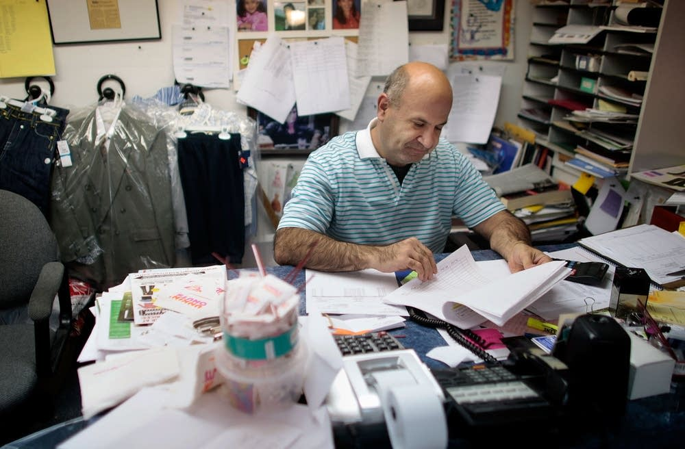 Micheal Steiner overlooks paperwork at his office.