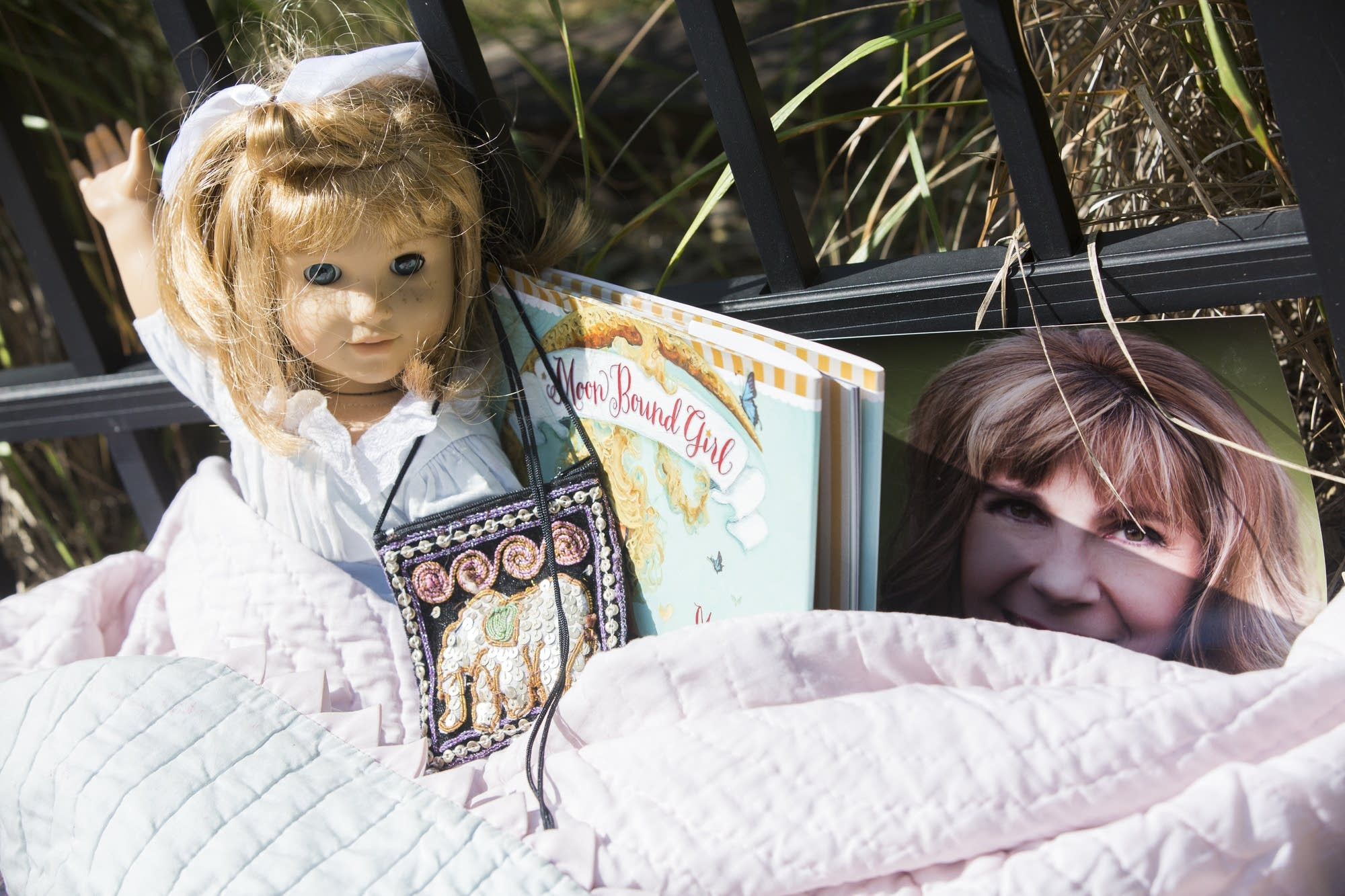 Mourners left dolls, books, flowers and photographs.