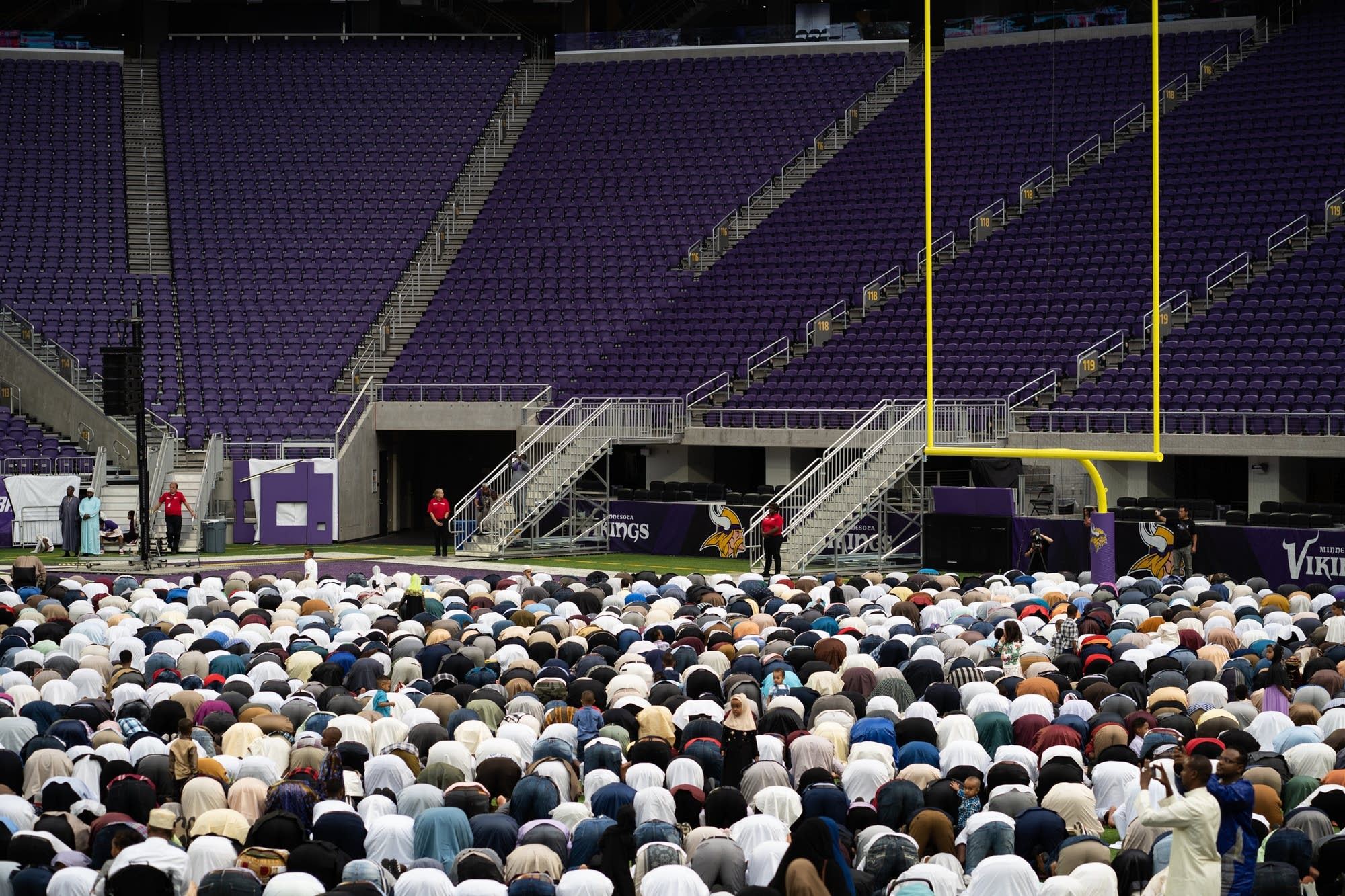 Thousands of people bow in prayer during the Super Eid celebration.