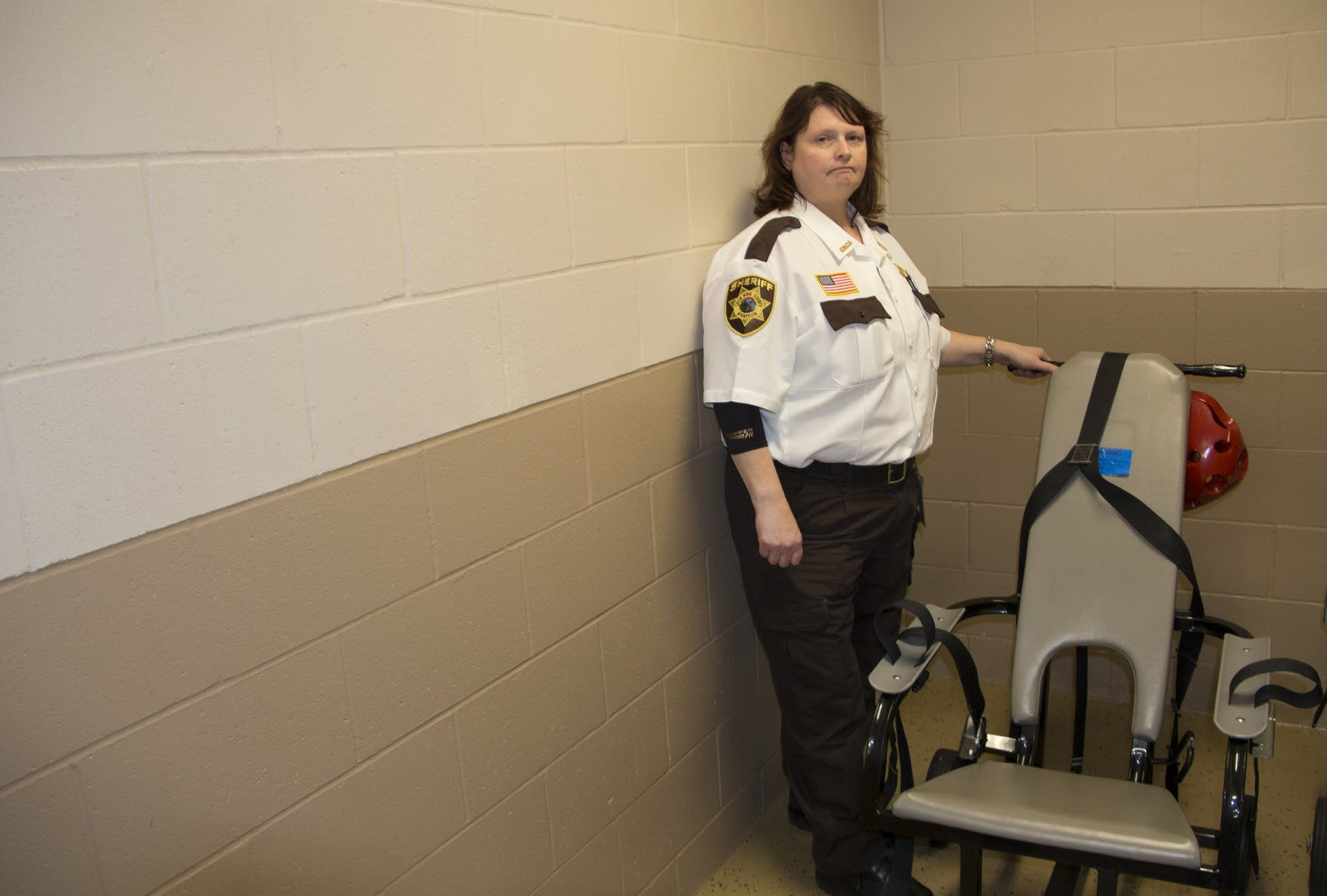 Crow Wing Co. asst. jail administrator Darnel Carlson with restraint chair.