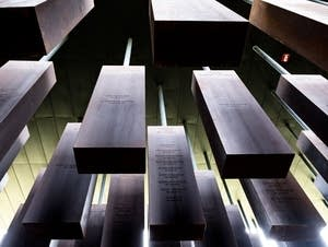 Pillars inscribed with the names of lynching victims from Southern states.