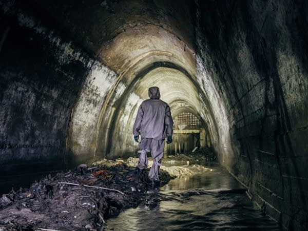 Sewer tunnel worker