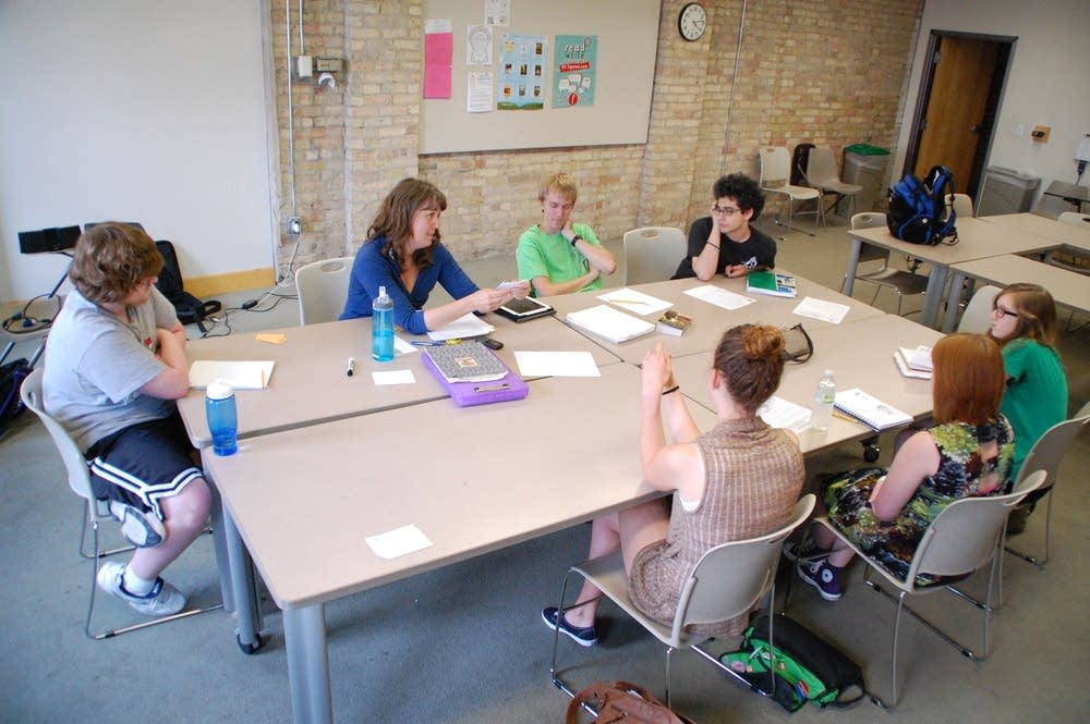 Teenagers attend a writing class at the Loft