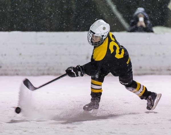 Snow flies as Quentin Roth fires a shot.