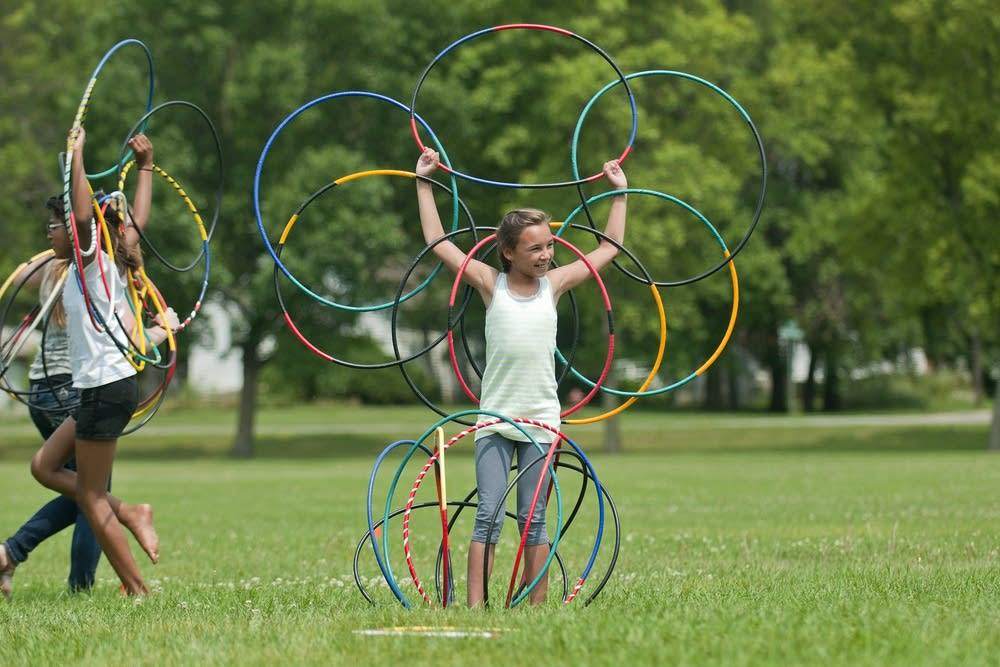 Gabrielle makes a flower during the hoop dance.