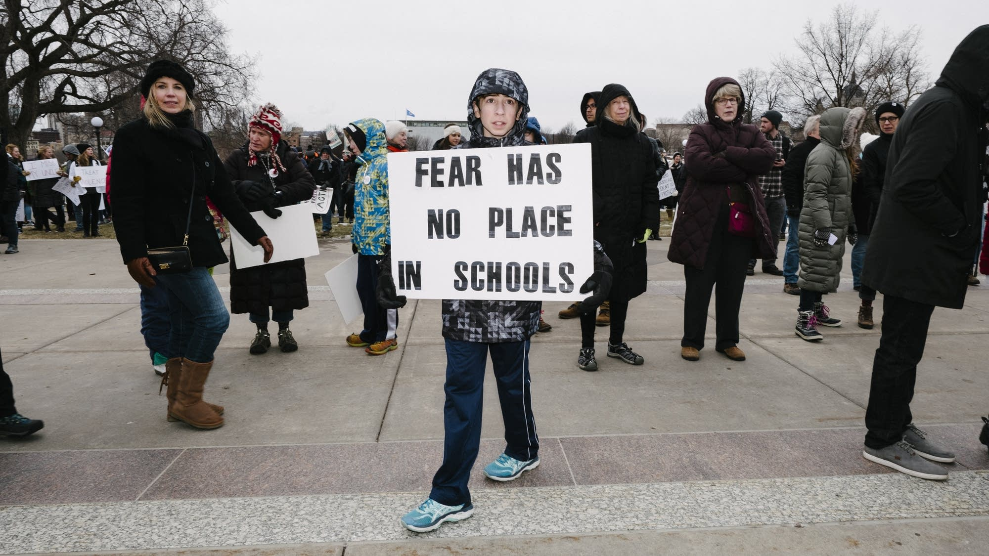 Seventh grader Matteo Beach stands on the steps of the State Capitol.