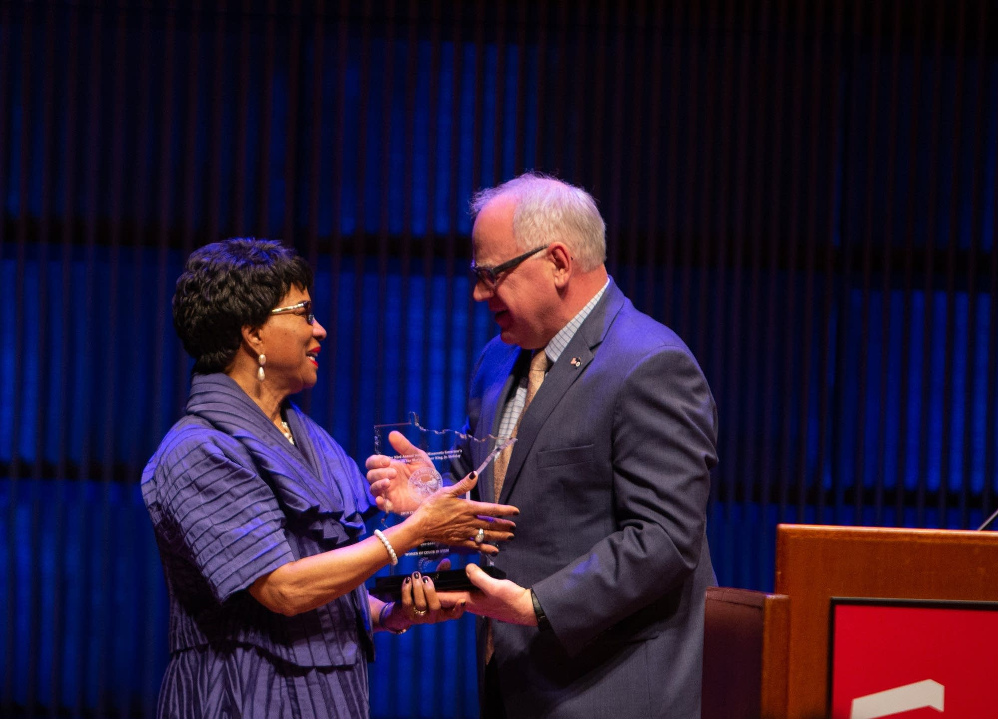 Gov. Tim Walz gives the Civil Rights Legend Award to Reatha Clark King.