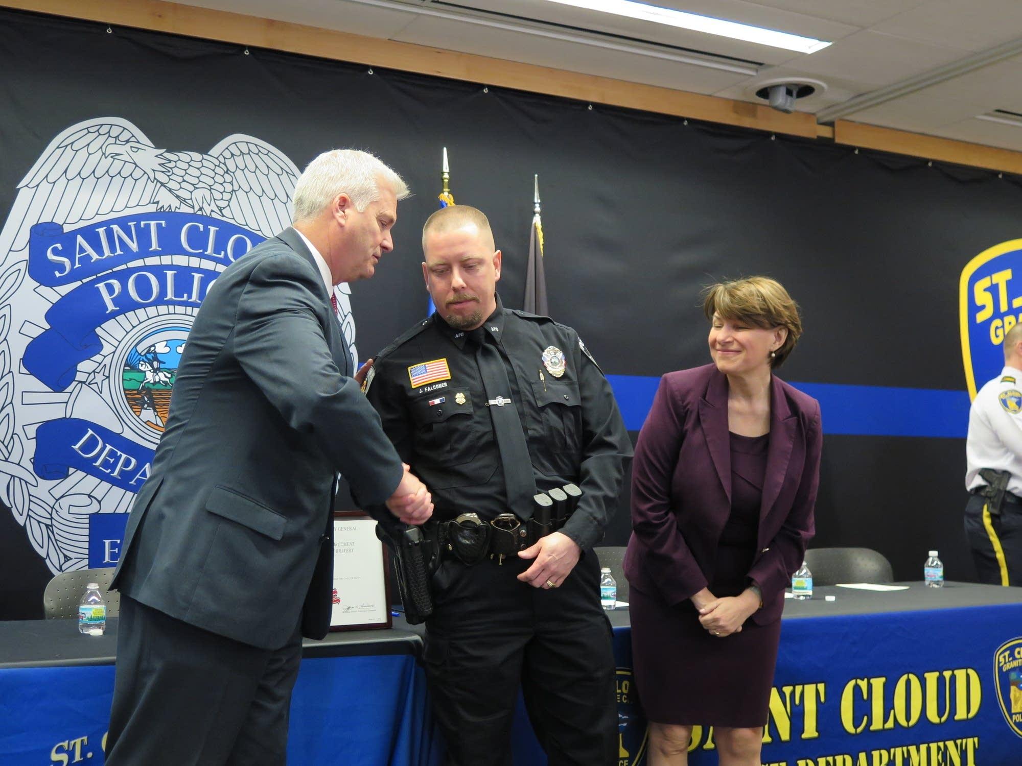 U.S. Rep. Tom Emmer and U.S. Sen. Amy Klobuchar congratulate Falconer.