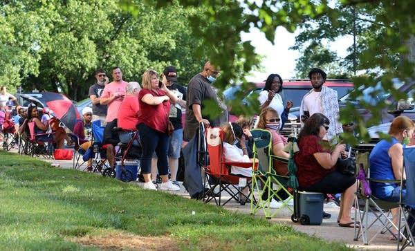 People wait in line.