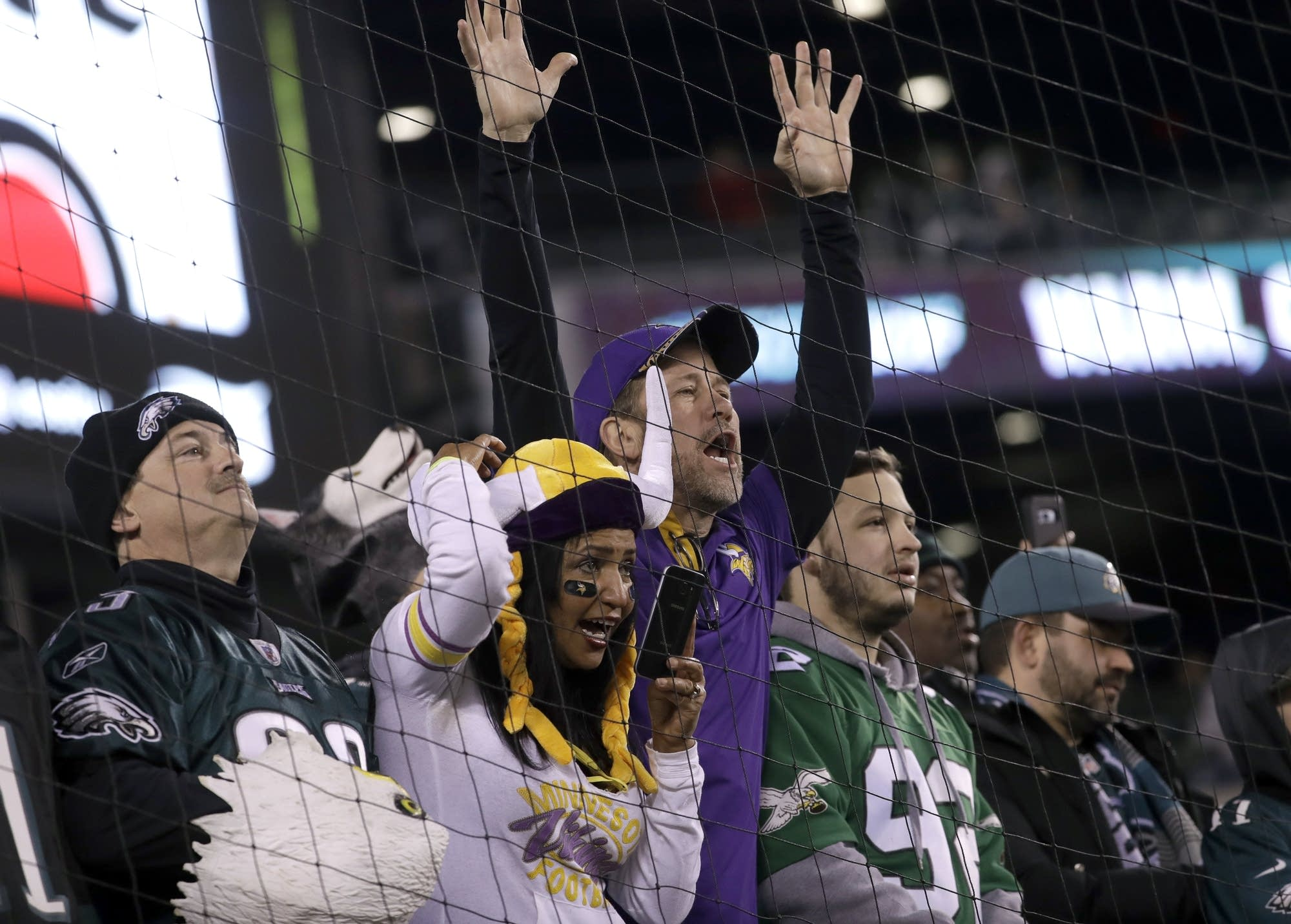 Fans watch warm ups before the NFL football NFC championship game.