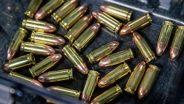 A close up of bullets in a tray.