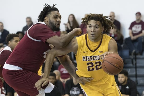 Center Reggie Lynch drives to the basket against Rashaan Holloway in Nov.