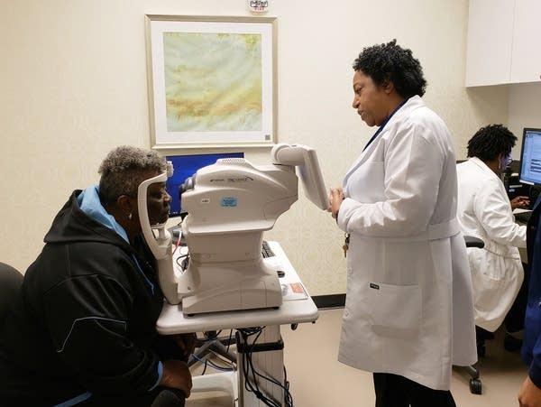 Nurse practitioner Debra Brown guides patient Merdis Wells