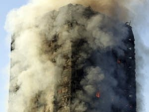 Smoke rises from a building on fire in London.