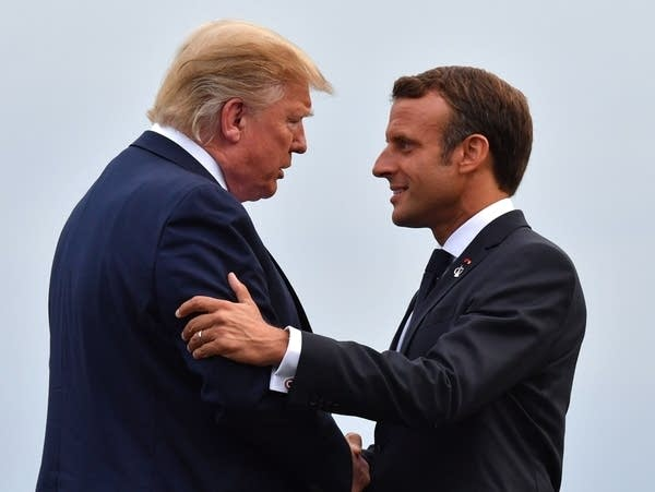 French President Emmanuel Macron welcomes U.S. President Donald Trump