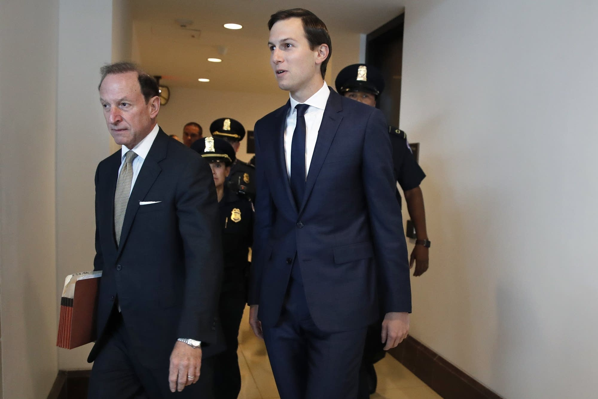 White House adviser Jared Kushner, right, and his attorney Abbe Lowell