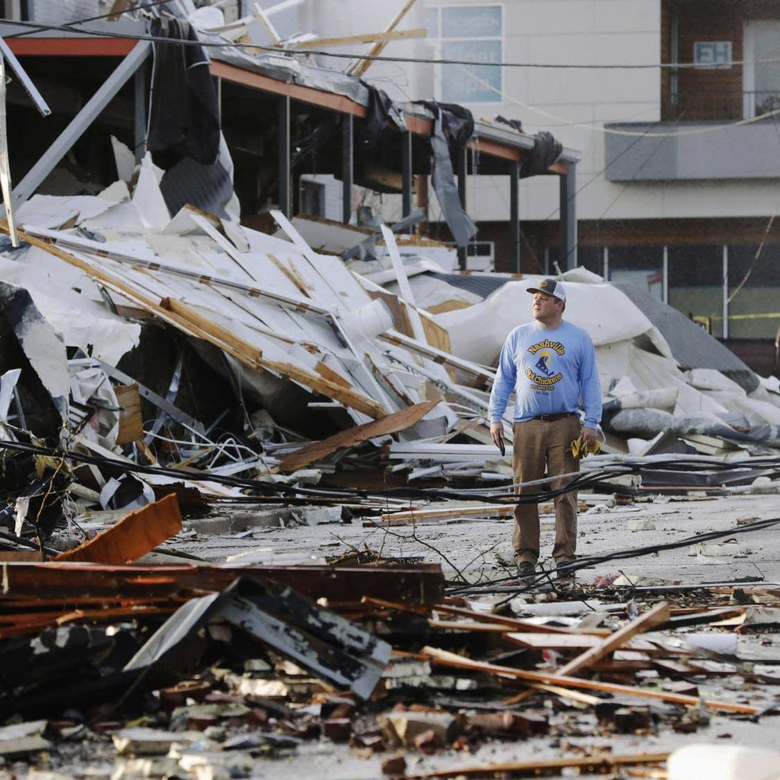 A man surveys tornado damage in Nashville on March 3, 2020