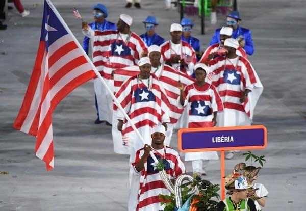 Liberia's flagbearer Emmanuel Matadi