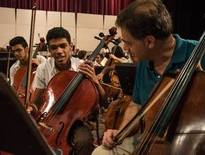 Principal cellist Tony Ross with a student