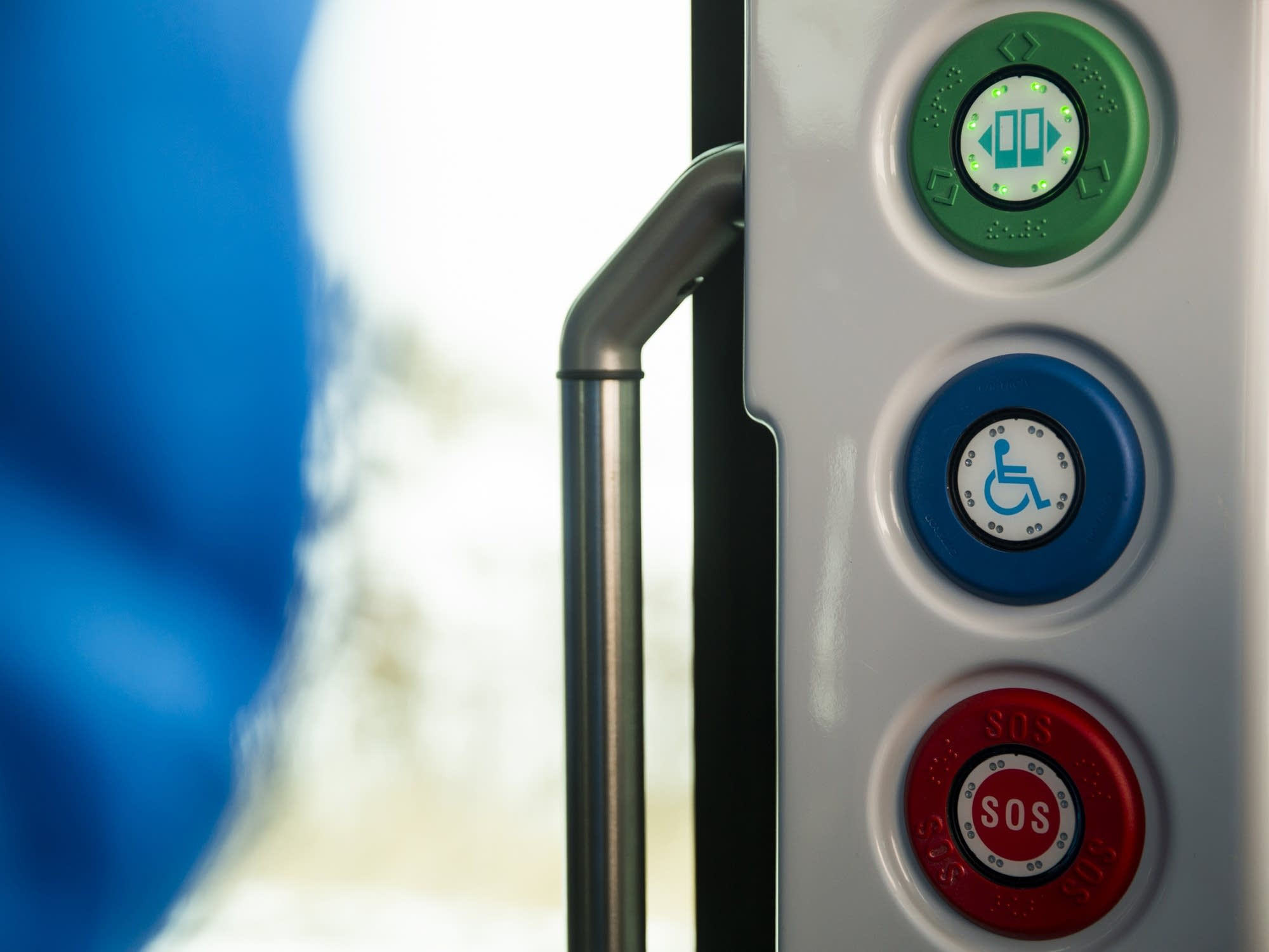 Door, disability and emergency buttons on the autonomous shuttle.