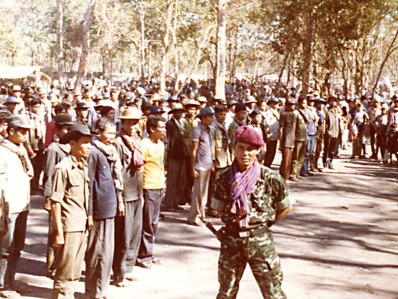 Soldiers gather in a Khmer Serai camp