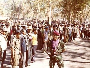 Soldiers gather in a Khmer Serai camp