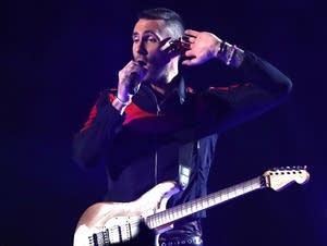 Adam Levine of Maroon 5 performs.