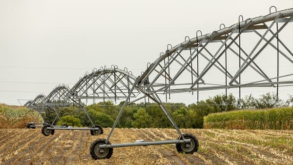 An irrigation system stretches across a field.