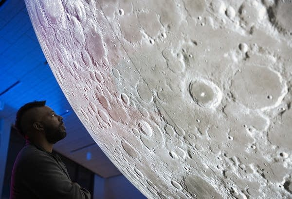 "Artist Donald Thomas gets an upclose view of the ""Museum of the Moon."""