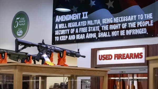 A close of up of a sign with information about the Second Amendment