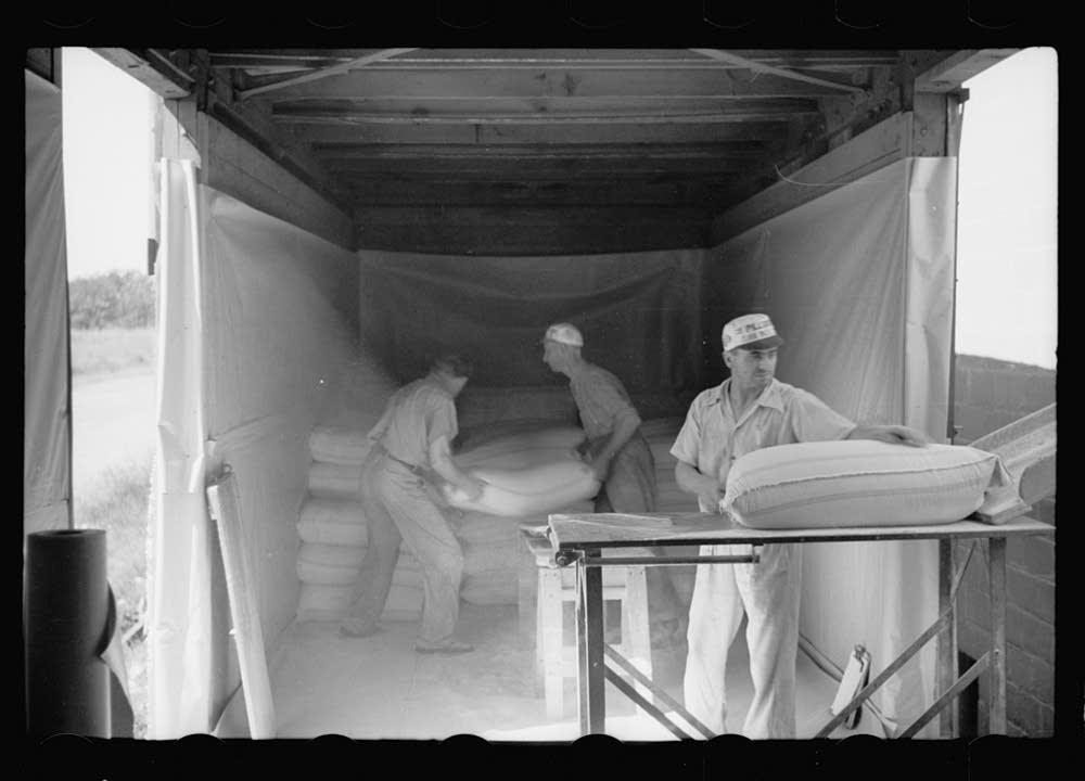 Loading flour onto freight car