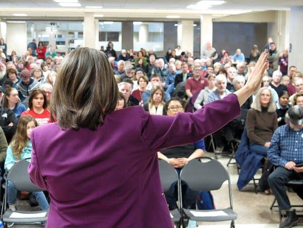 Congresswoman Angie Craig talks at a town hall at Burnsville High School