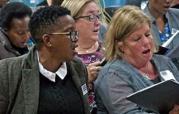Buyi Masikane of Gauteng Choristers, Debbie Richman of the Minn. Chorale