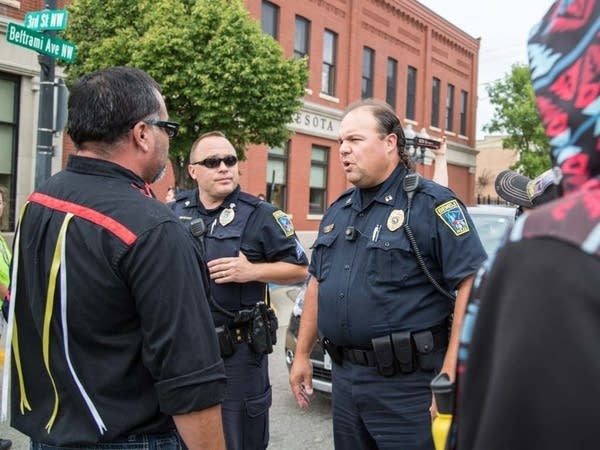 Marty Cobenais talks to police.