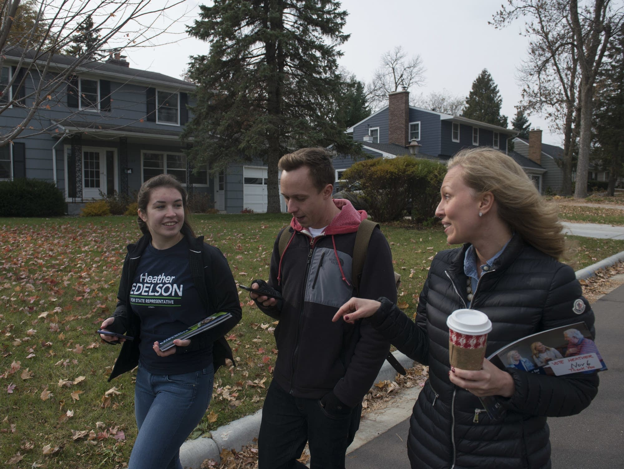 Macy Rooney, Nick Galli, and Heather Edelson walk down the street in Edina