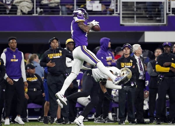 Vikings wide receiver Stefon Diggs (14) makes a catch to win the game.