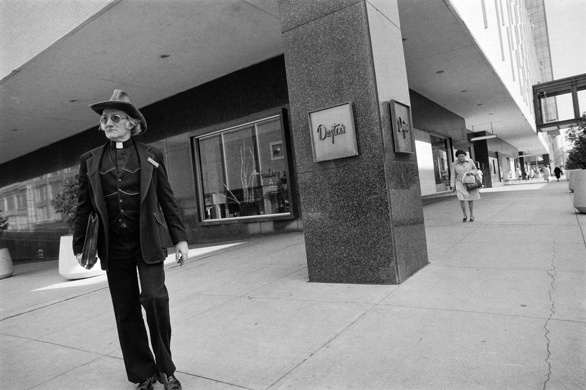 A minister stands in front of Dayton's at 7th Street and Wabasha.