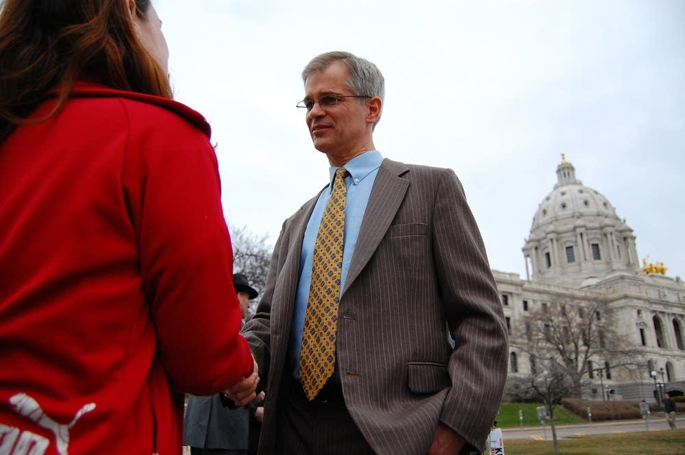 Sen. John Marty speaks with supporters