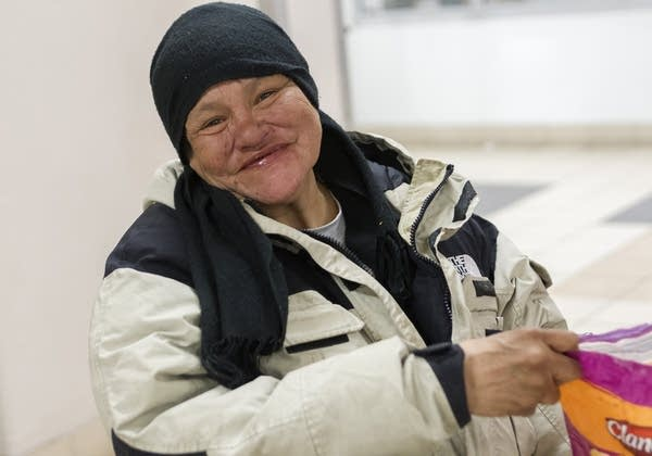 Mattie Grassrope is one of dozens who wait indoors at the LRT at the MOA.