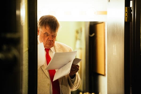 Keillor reads through scripts backstage at the Fitzgerald Theater