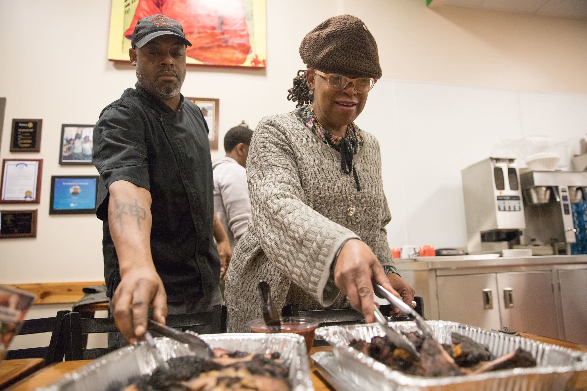 Brandy Baum (left) and Tene Wells start digging into two of the dishes.