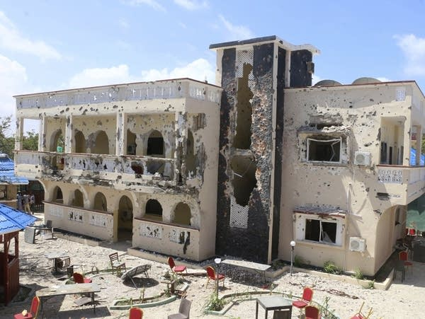 The damaged Asasey Hotel in Kismayo, Somalia