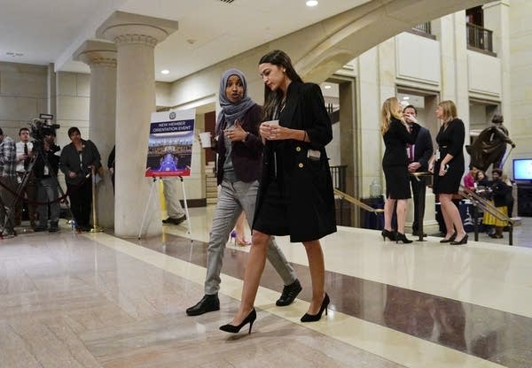 Reps.-elect Alexandria Ocasio-Cortez, right, and IIhan Omar