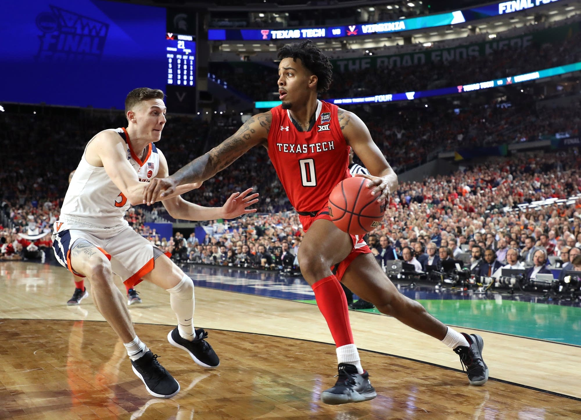 Kyler Edwards (0) of Texas Tech is defended by Kyle Guy (5) of Virginia
