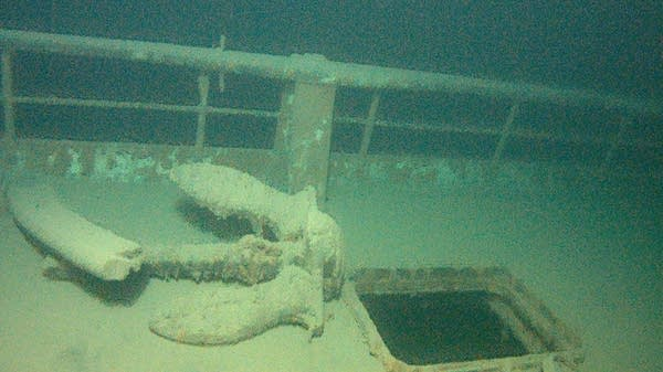 An anchor is seen on the deck of the wrecked freighter Hudson