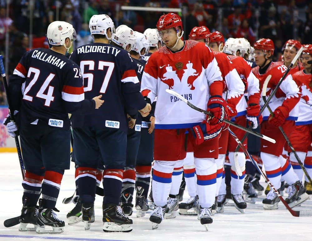 Russian and American players shake hands