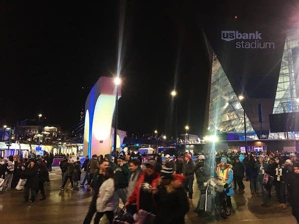 Super Bowl attendees stream out of the stadium after the game.