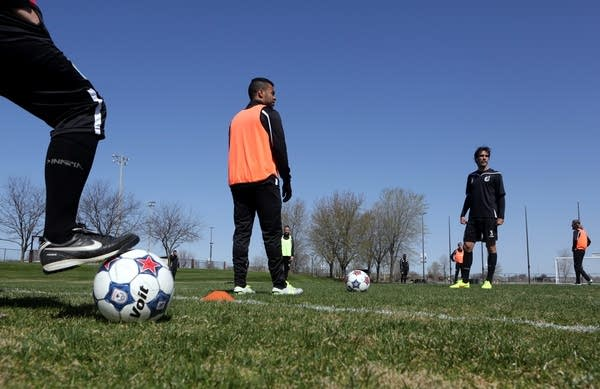 Minnesota United players listened before a drill.
