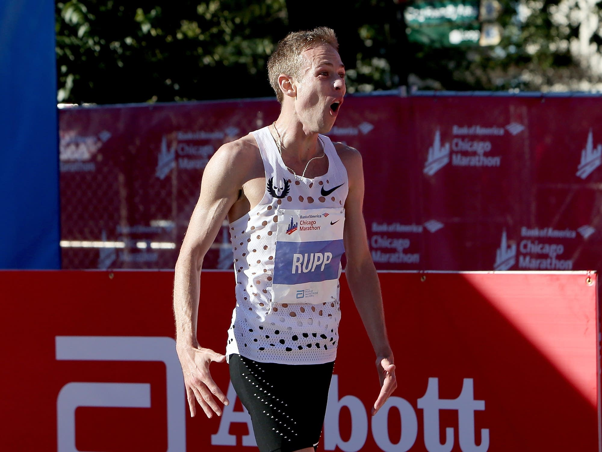 Galen Rupp of the United States celebrates after winning the men's race.