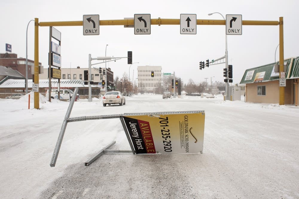 A realty sign blocks traffic in downtown Moorhead.